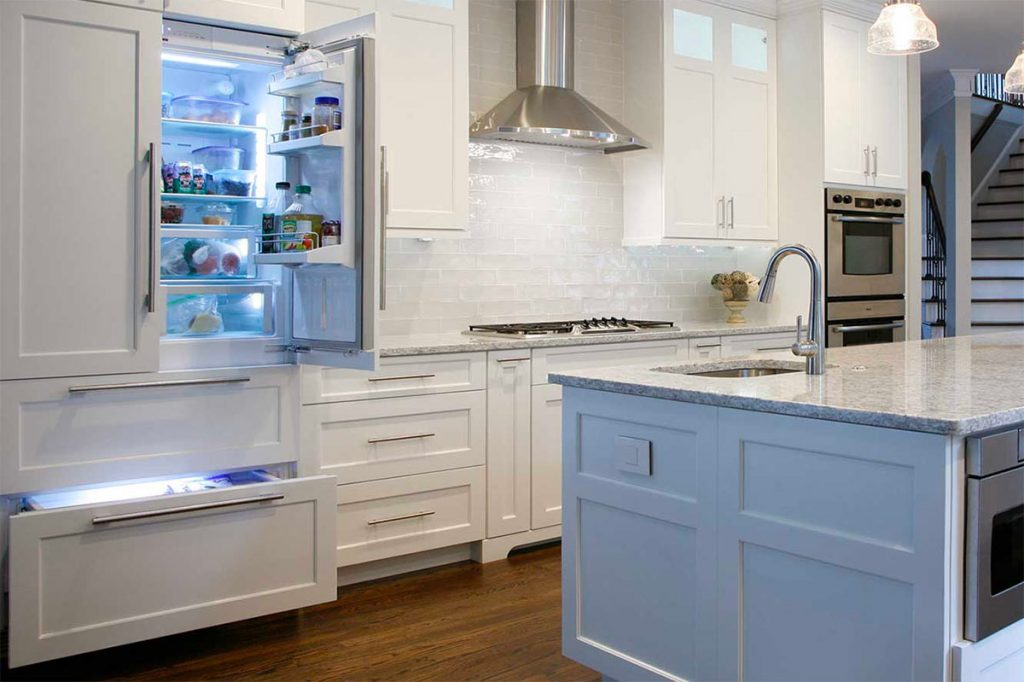 Custom built-in refrigerator blends with cabinets