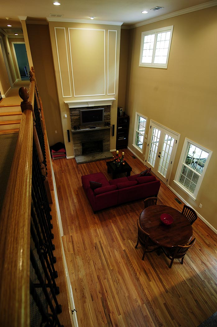 View toward living room fireplace from second floor balcony