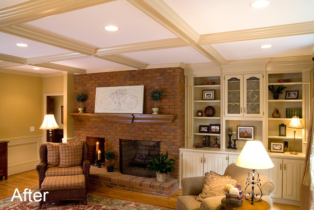 Fireplace, built-in bookcases, and coffered ceiling after extending second floor