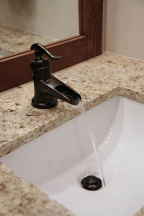 Contemporary faucet in basement bathroom