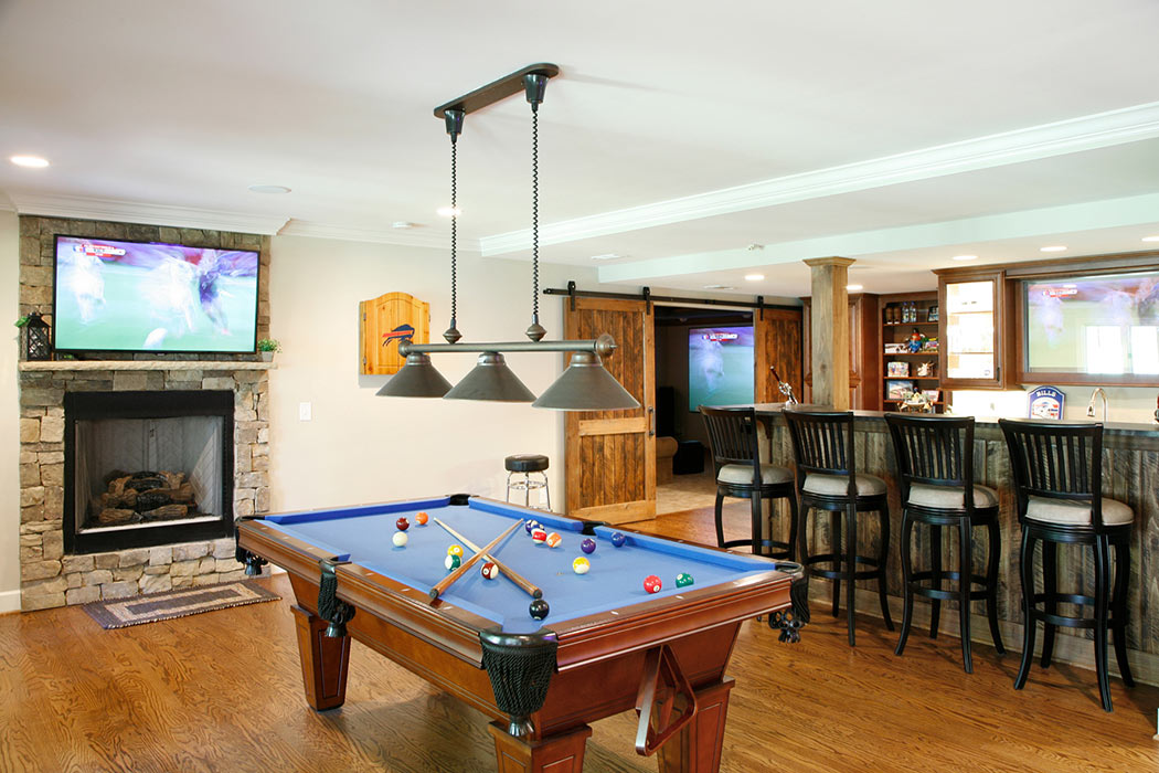 Remodeled basement incudes a gaming area, wetbar, and home theater