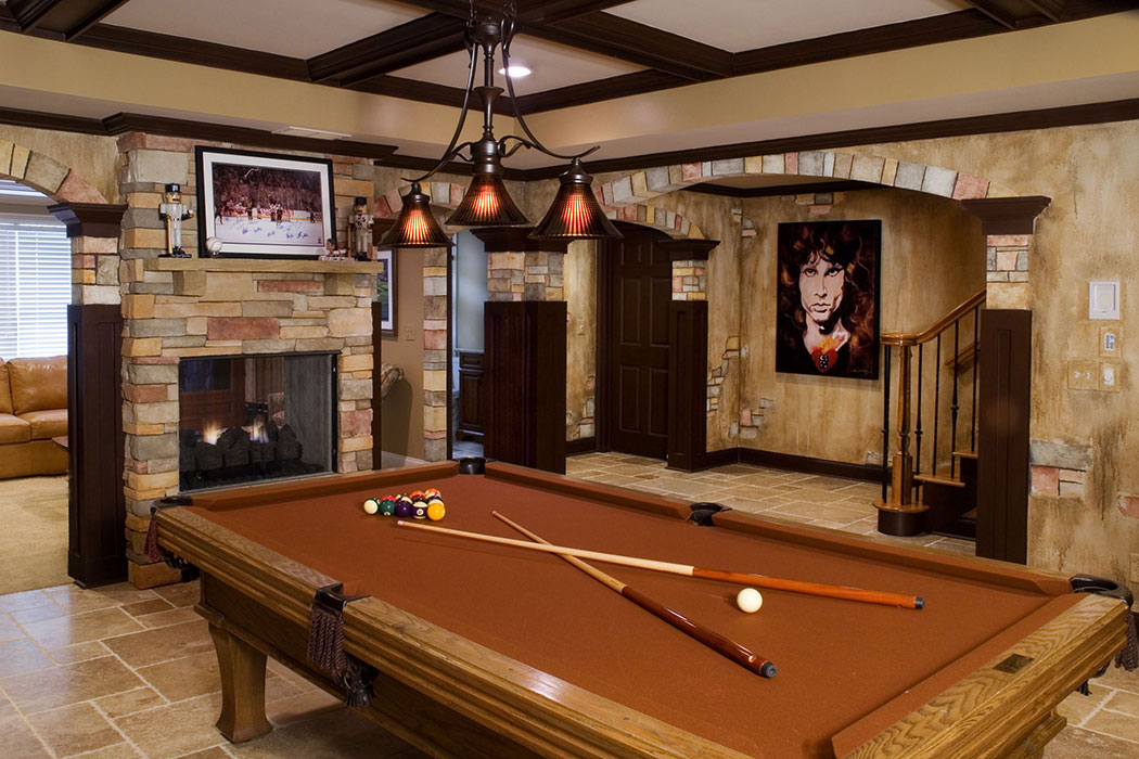 Remodeled basement with pooltable and fireplace