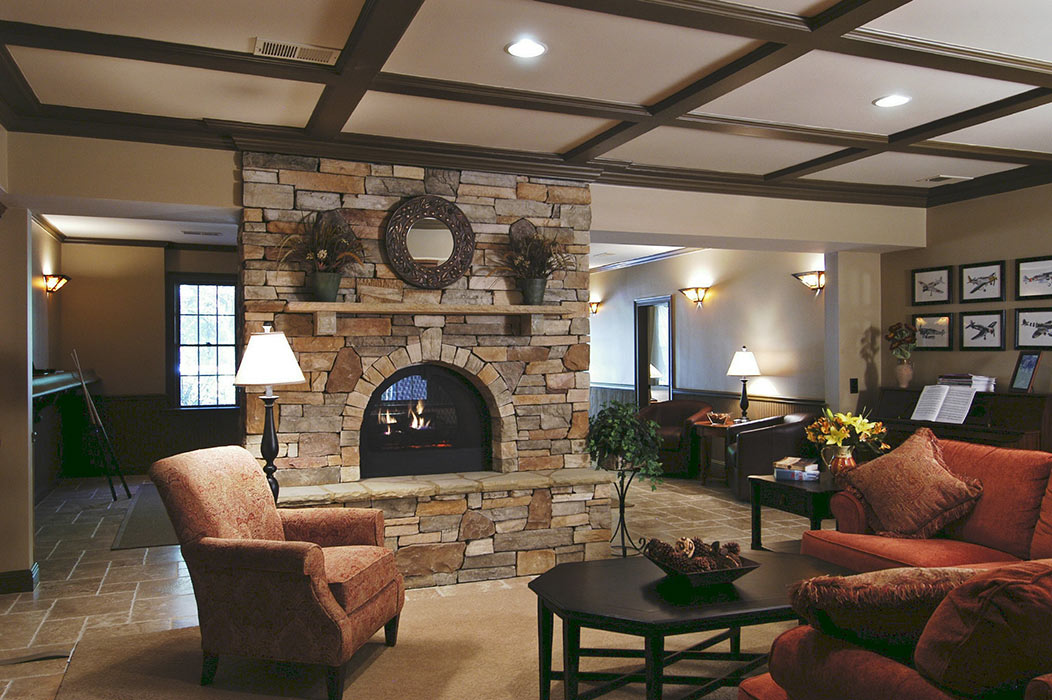Stacked stone pass-through fireplace in basement remodel