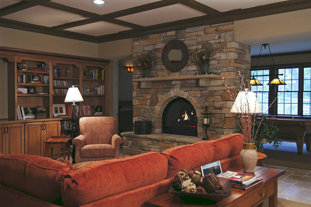 View of full basement with fireplace, bookcases, and gameroom