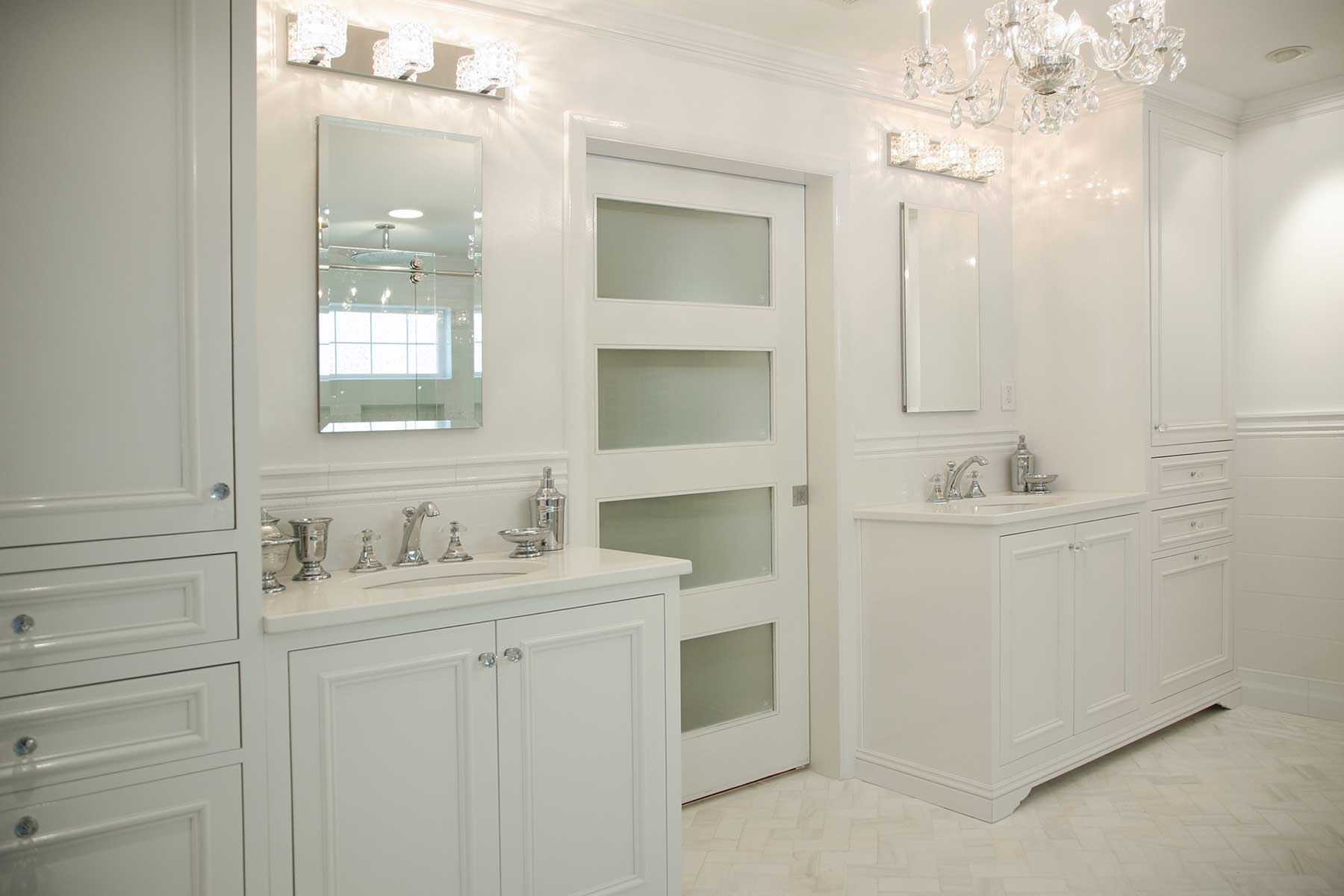All white bathroom with chandelier