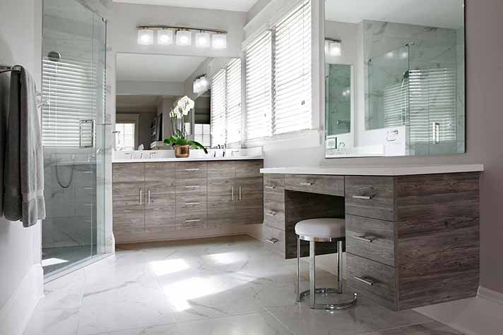 remodeled bathroom with floating vanities