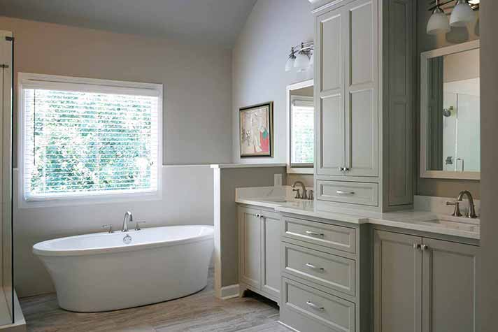 remodeled bathroom with luxury tub and plenty of storage