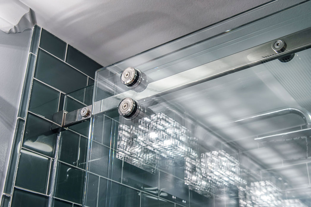 Picture of frameless glass shower doors with bold wall tile