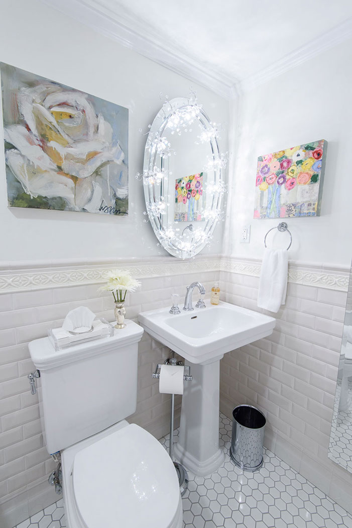 Second bathroom with white wall and floor tile