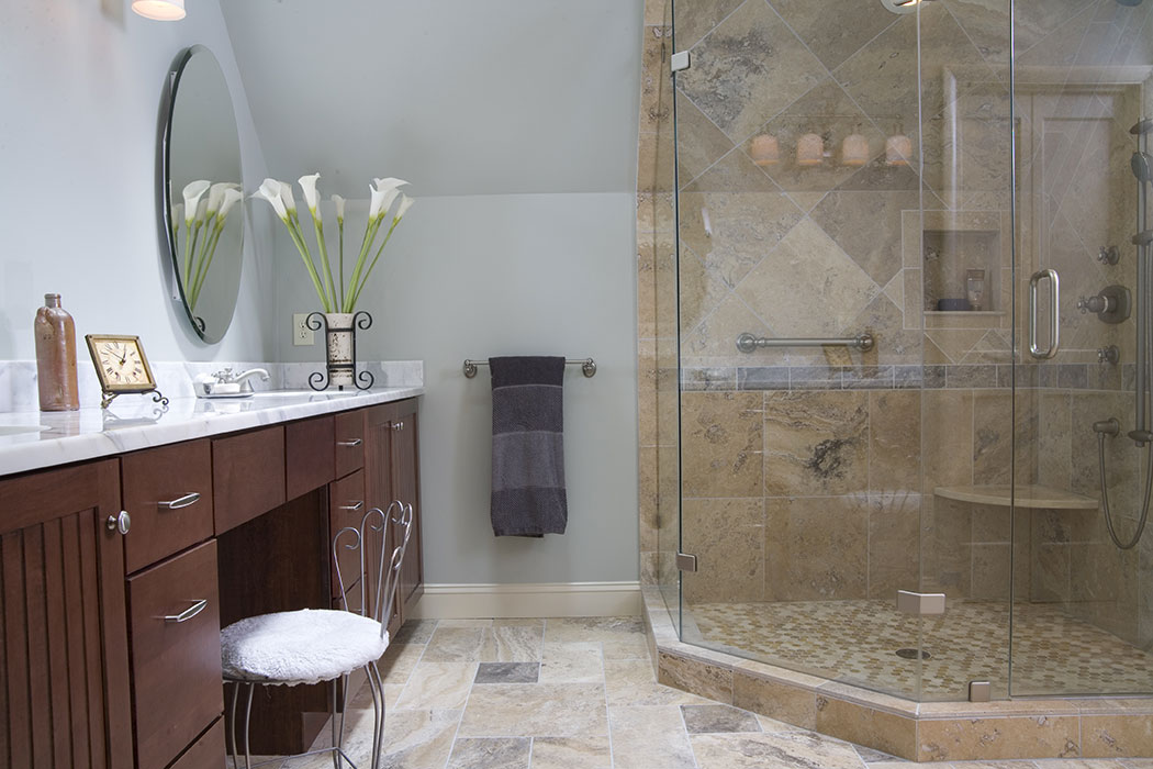 View of newly remodeled bathroom showing vanity and custom tile shower