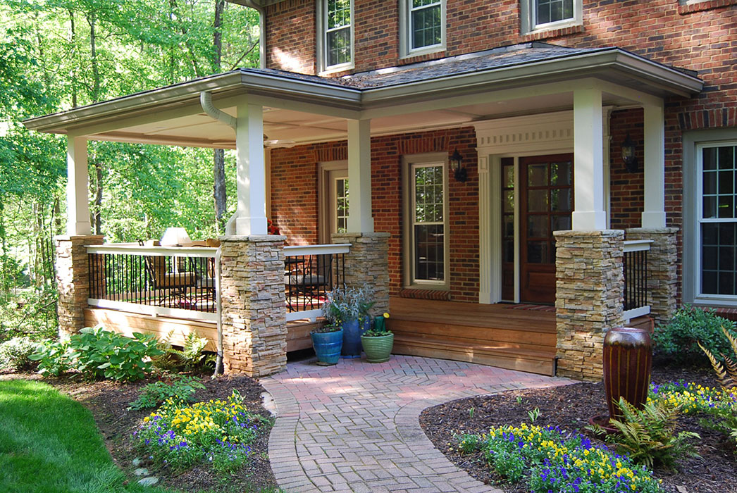 Close-up of brick walkway and stone pillars for porch