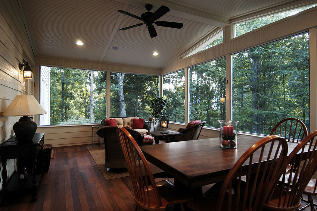 View of screened porch dining and living areas