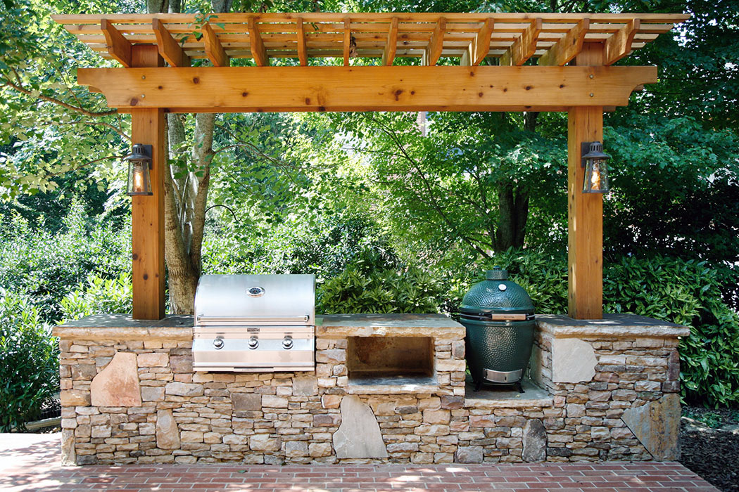 Stacked stone outdoor kitchen with pergola