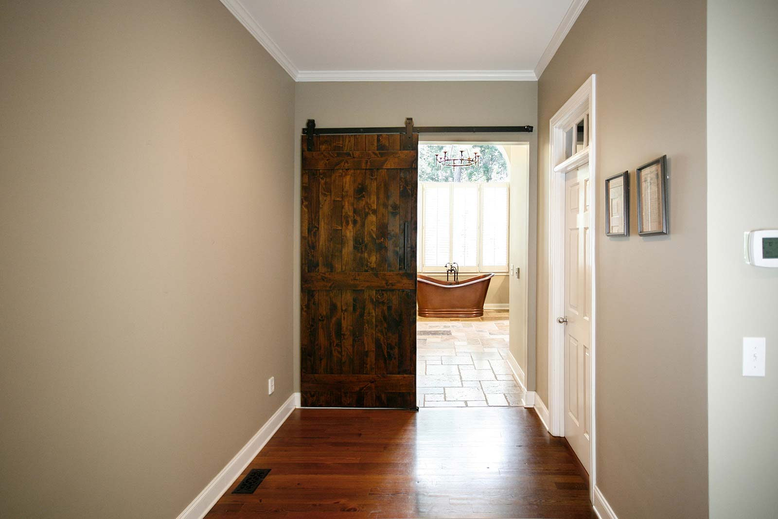 Barndoor style doors leading to bathroom