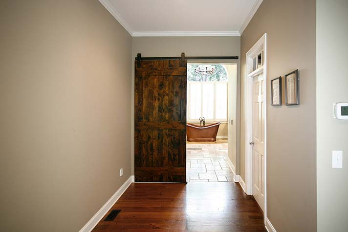 Interesting use of barn door style doors in interior remodeling.