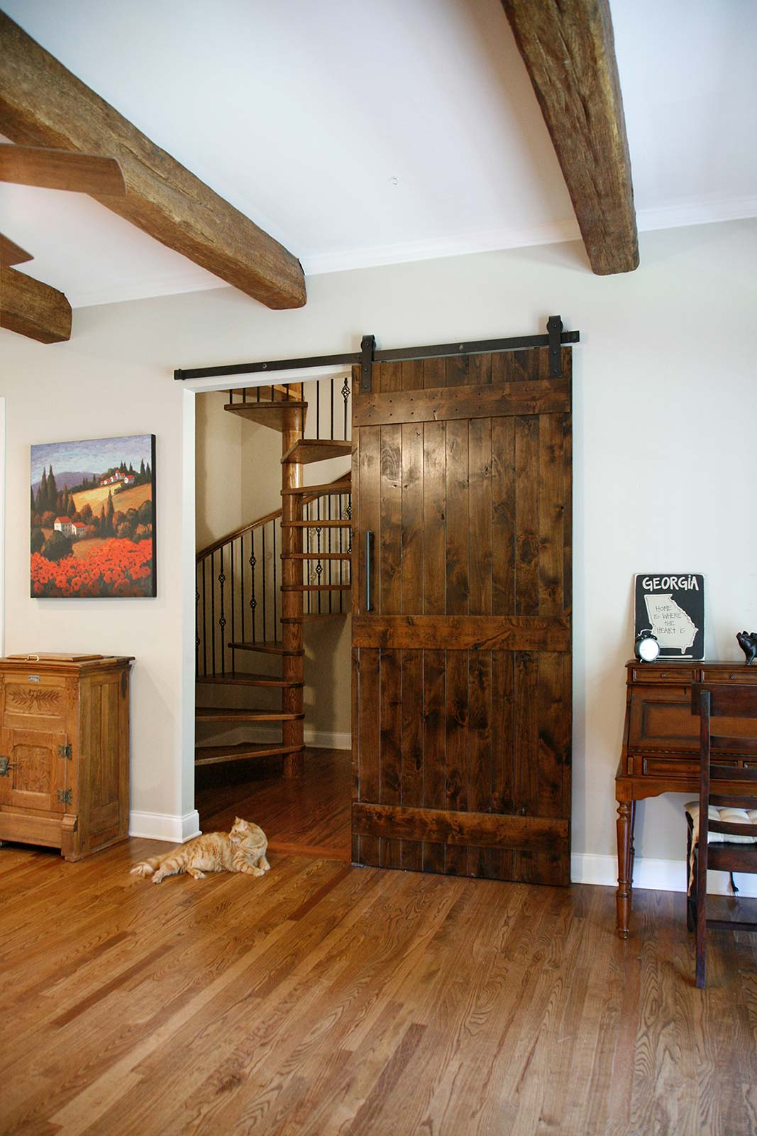 View into stairway through barndoor