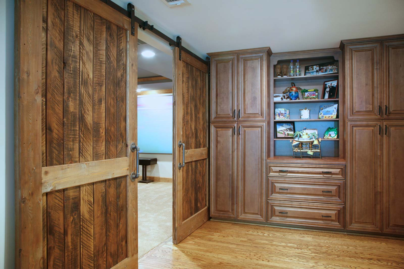 Double barndoors open to reveal home theater