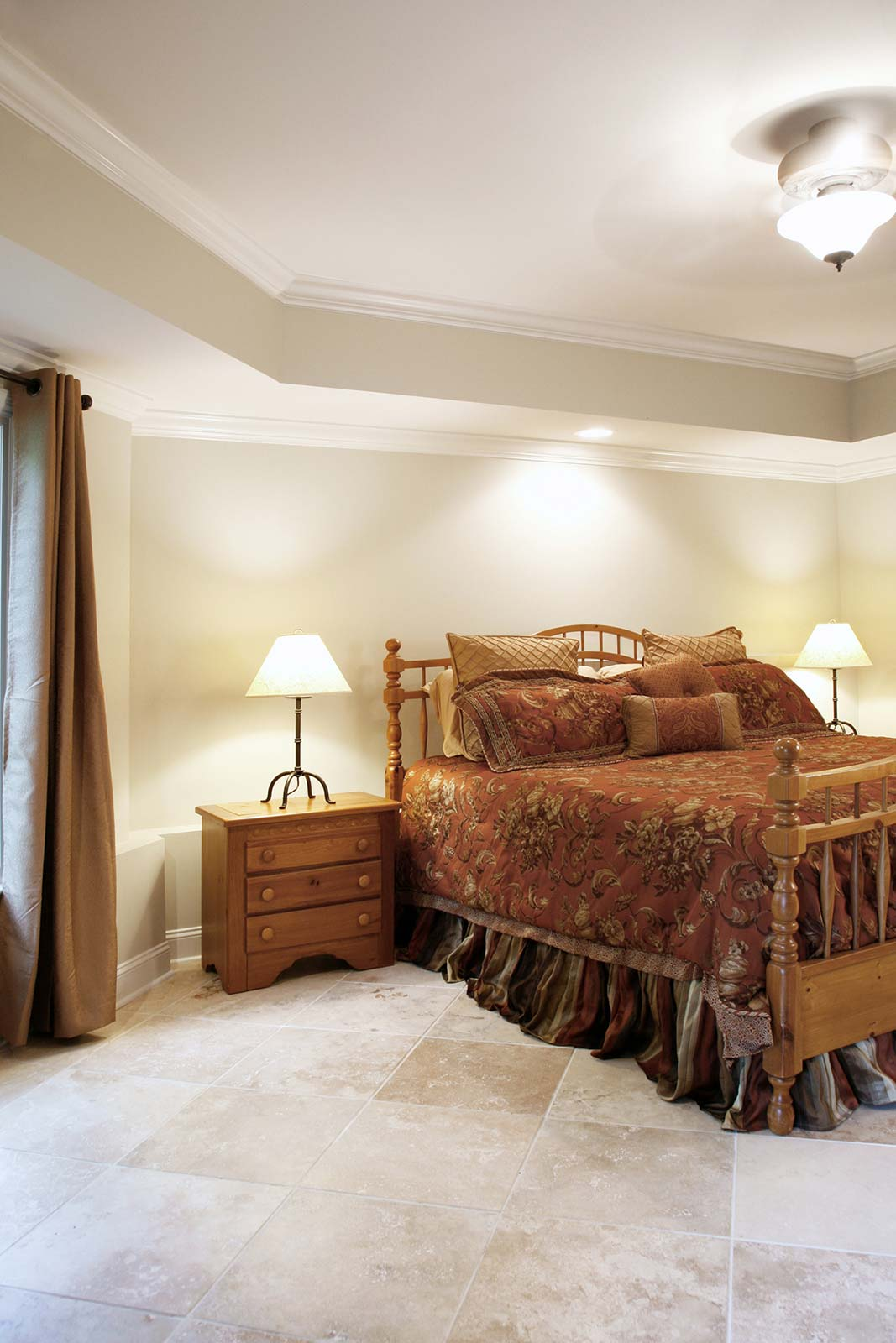 Remodeled bedroom including a tray ceiling to add height