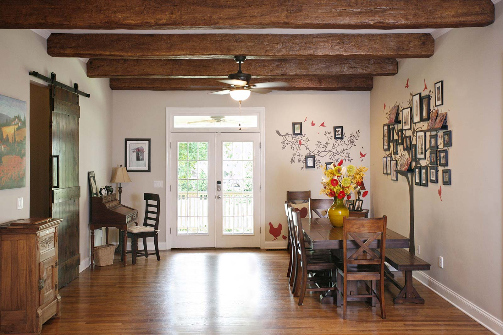Exposed beams over dining room remodel