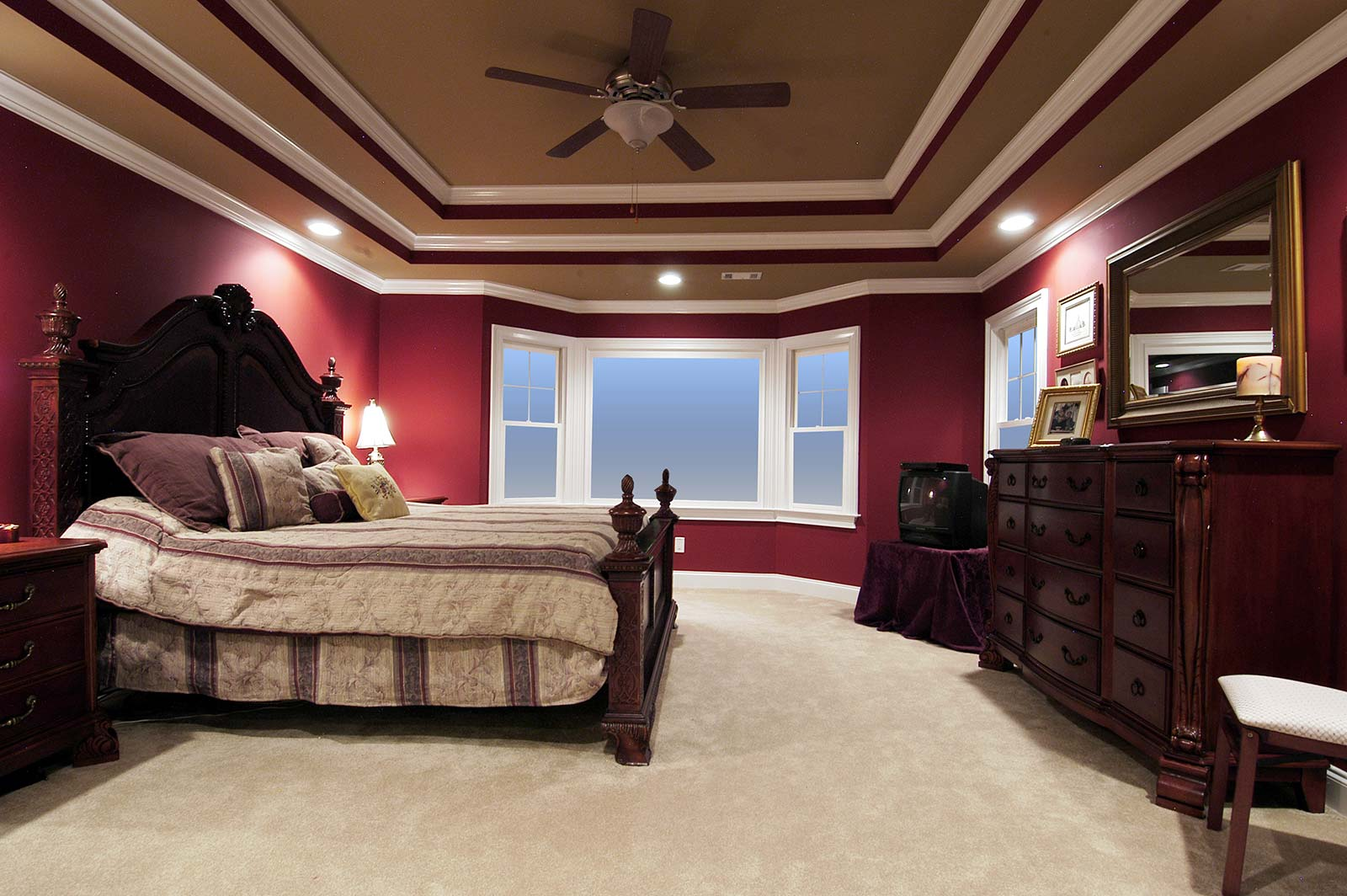 Dramatic double-tray ceiling in bedroom