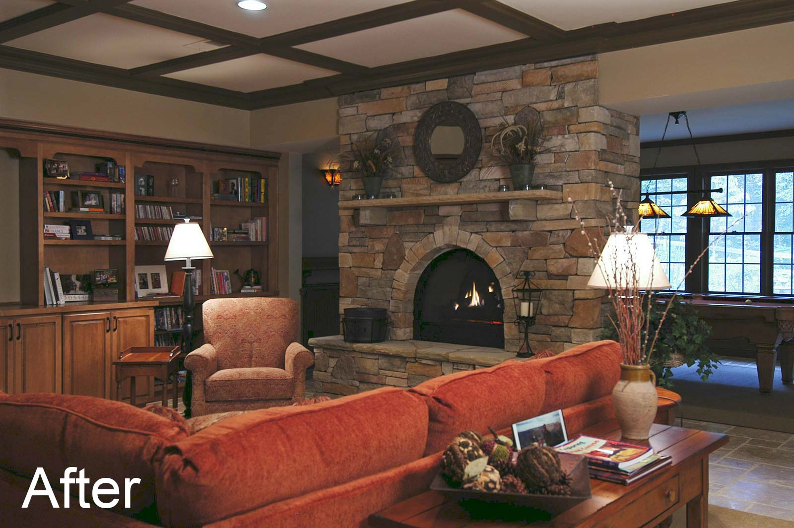 After fireplace was redesigned with various sized stones and an arched opening