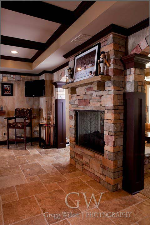 Stone fireplace in basement gameroom
