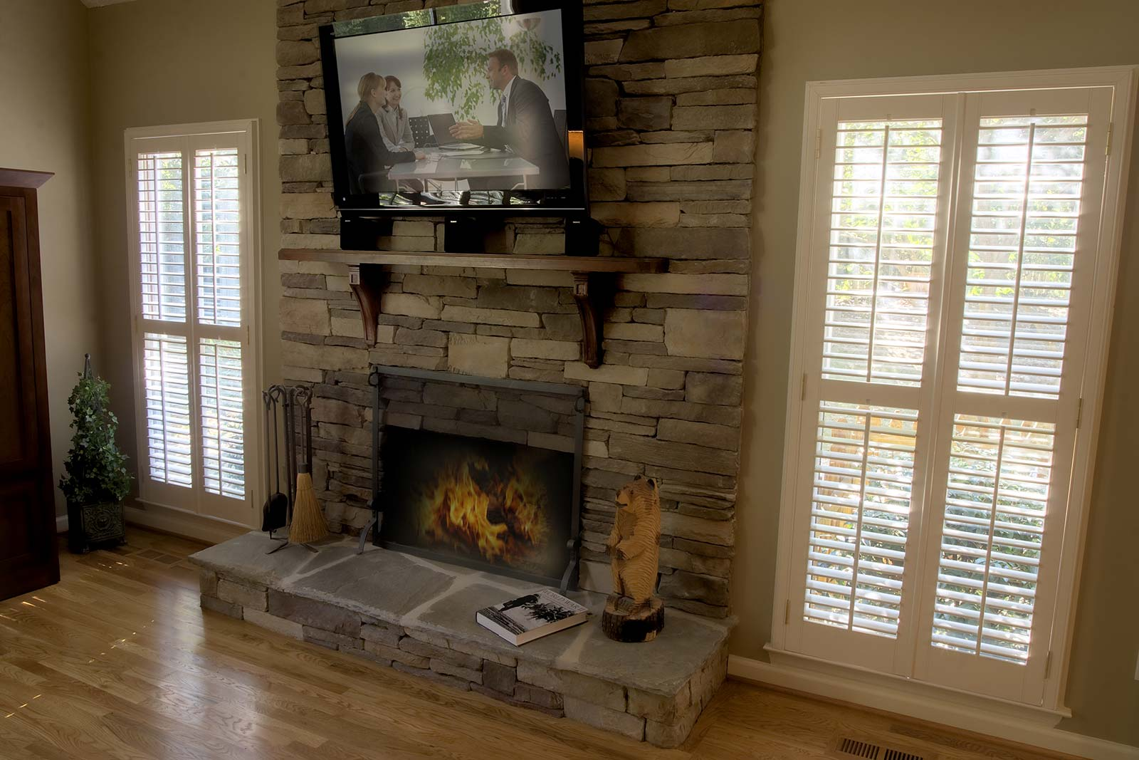 Stacked stone fireplace with tv monted above