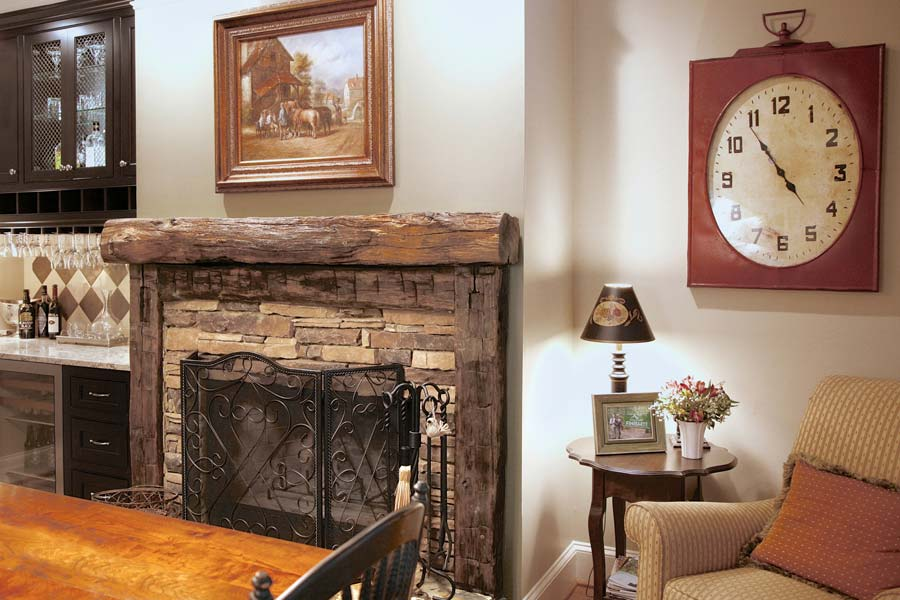 Rustic timbers and stone surround added to this fireplace