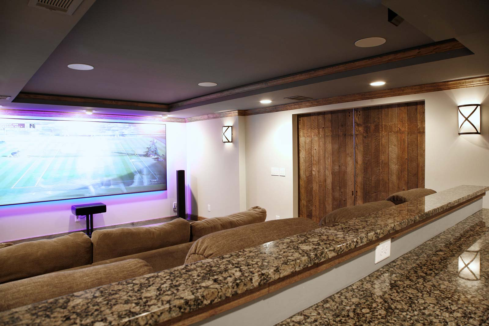 Inside newly added home theater with barndoors closed