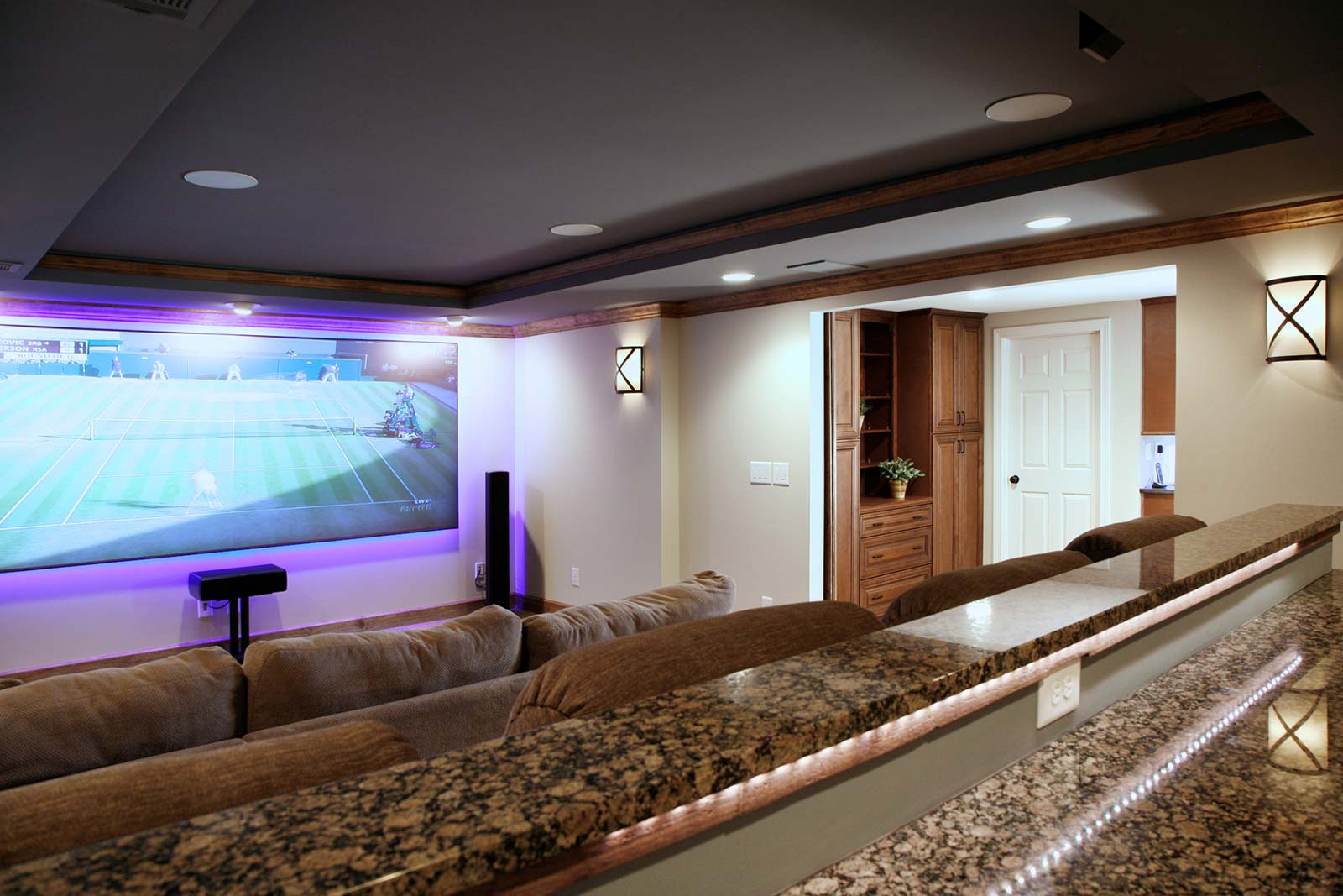 Inside newly added home theater with barndoors open