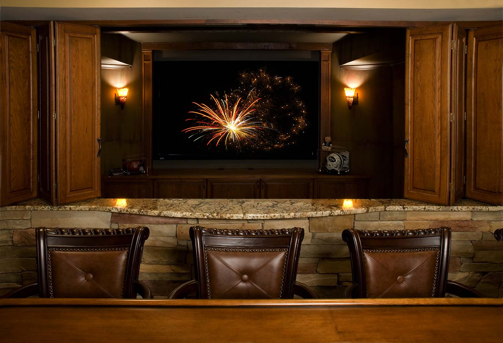 Basement home theater viewed from bar area