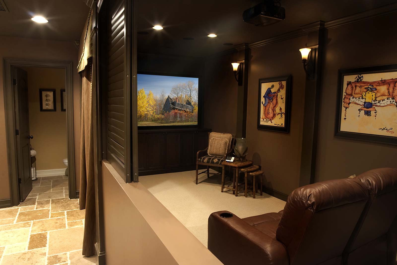 Home theater with sliding panel half-wall open