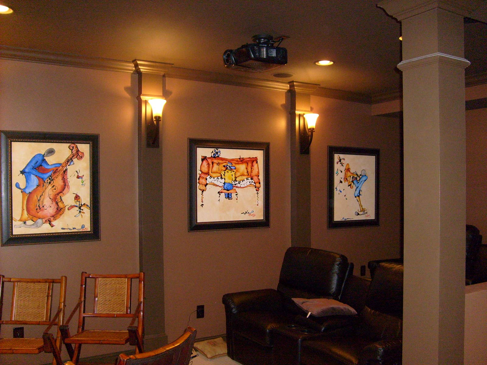 Home theater seating and wall sconces for lighting