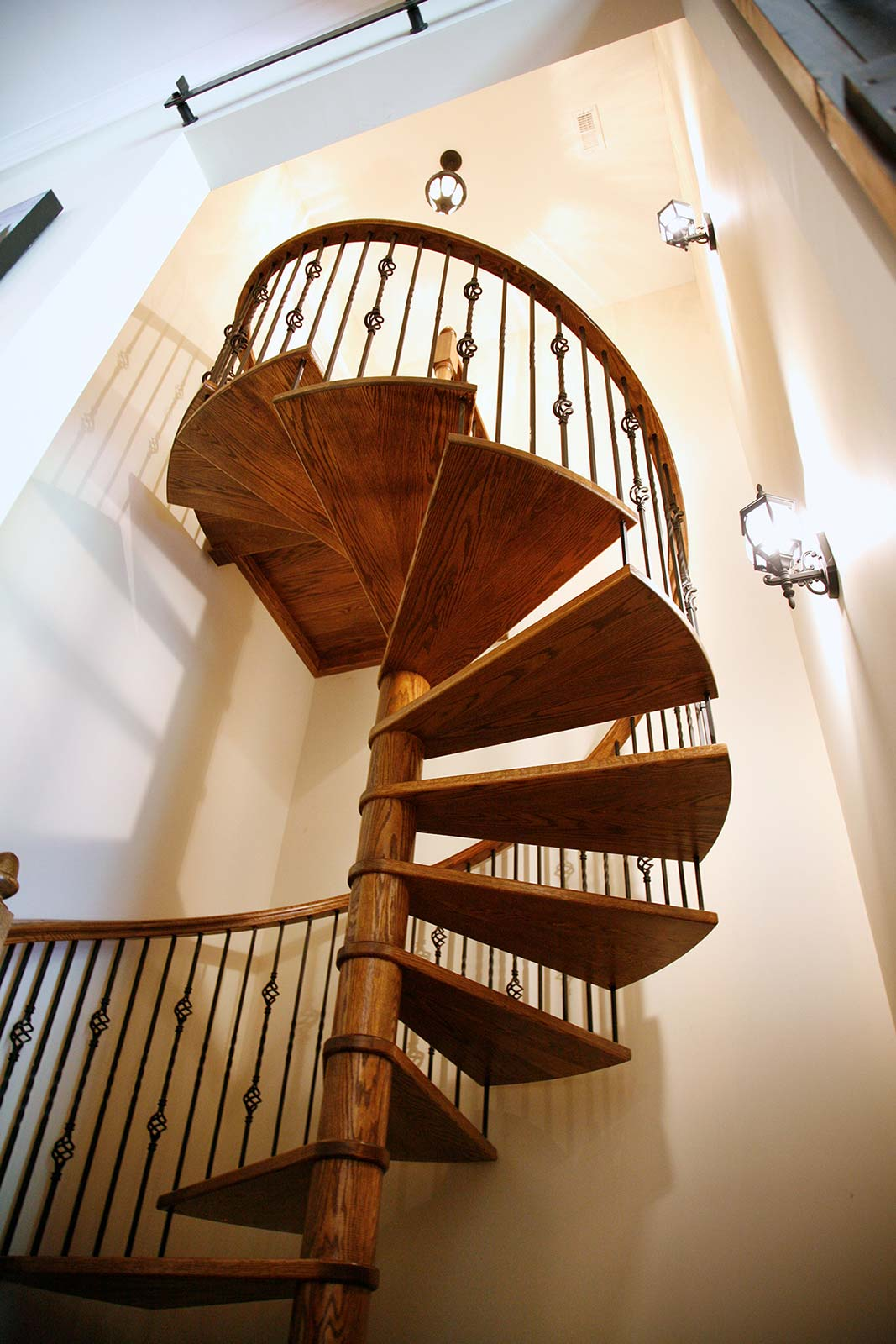 View from below wooden spiral stairway