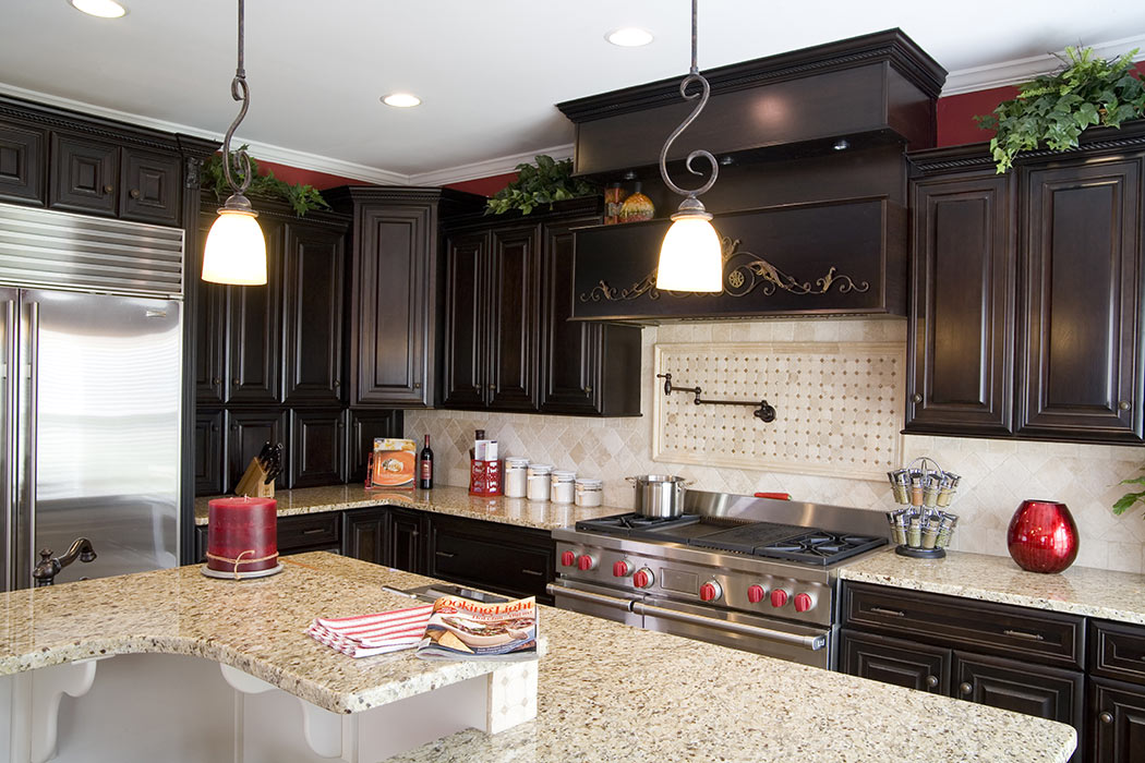 View of multi-level kitchen island and pendant lighting