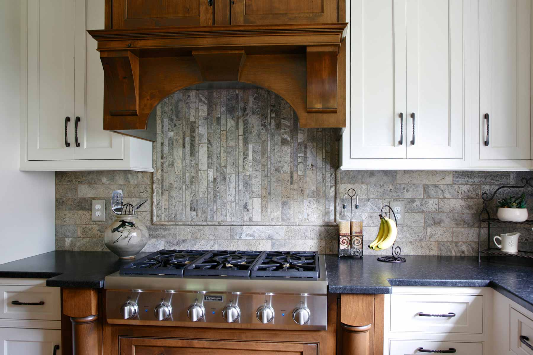 Stone tile backsplash was used in this kitchen remodel