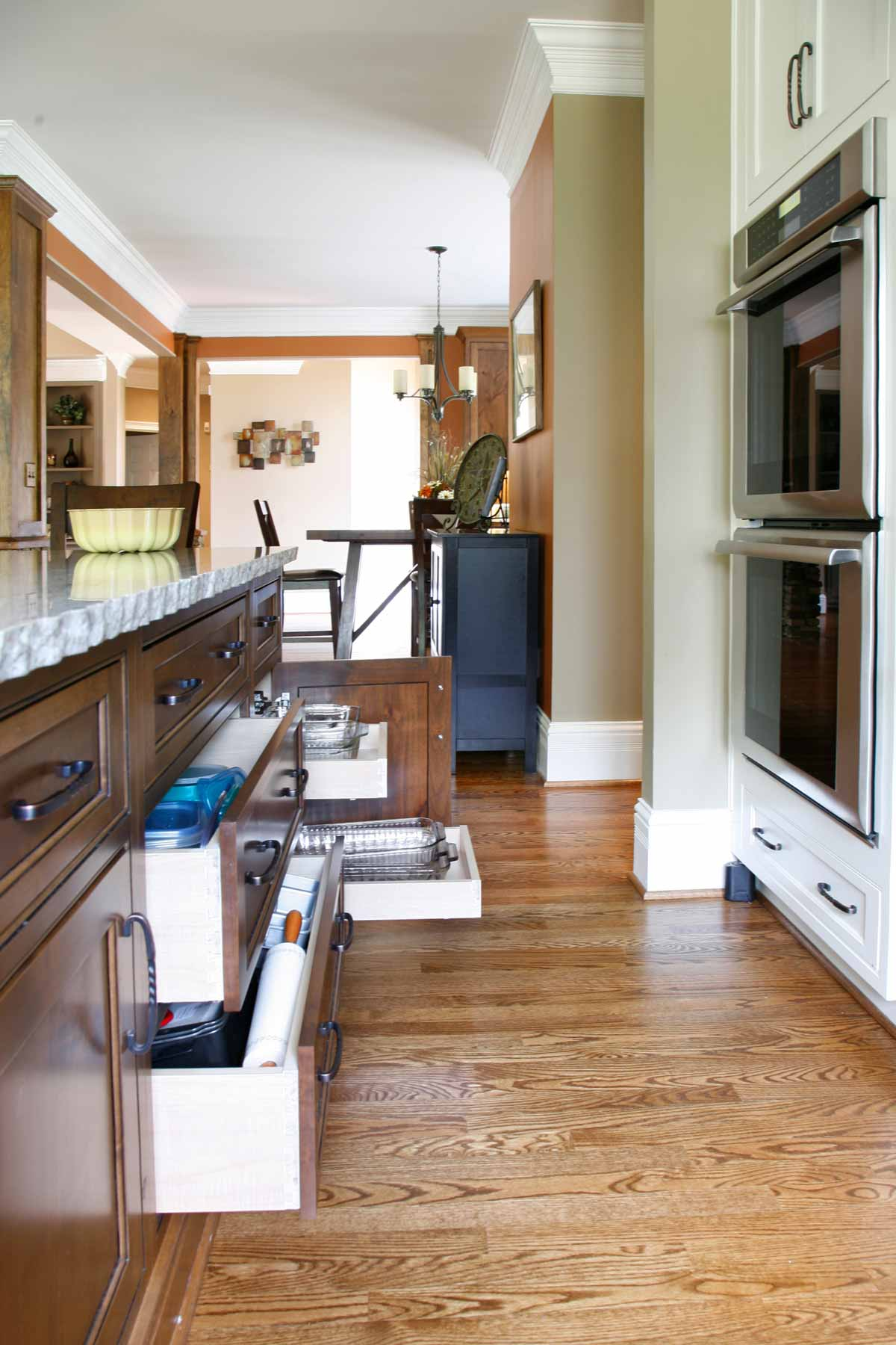 Kitchen island houses pull out storage drawers