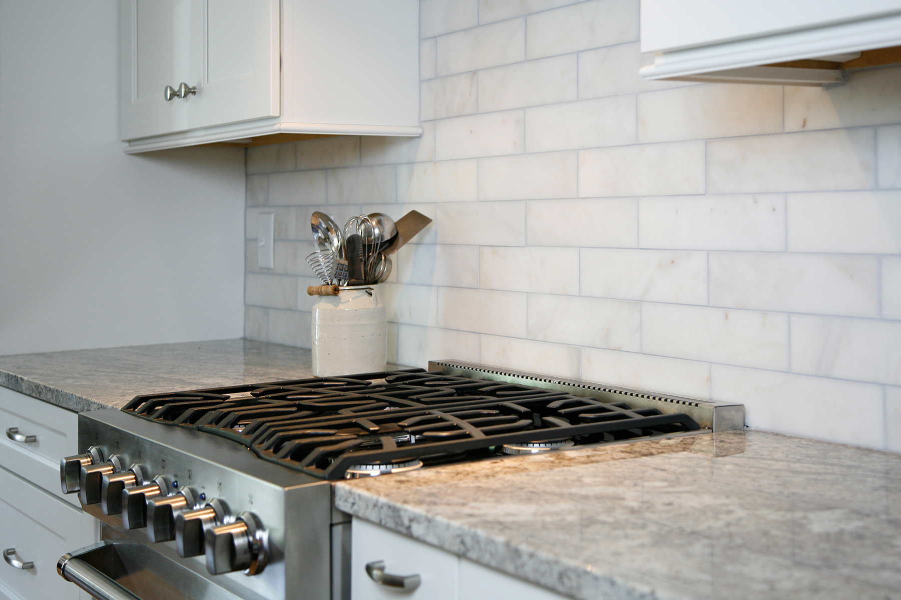 Close-up of stove and backsplash after