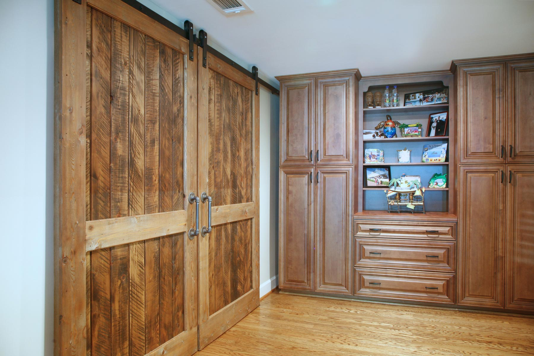 Built-in cabinets and barndoors leading to home theater