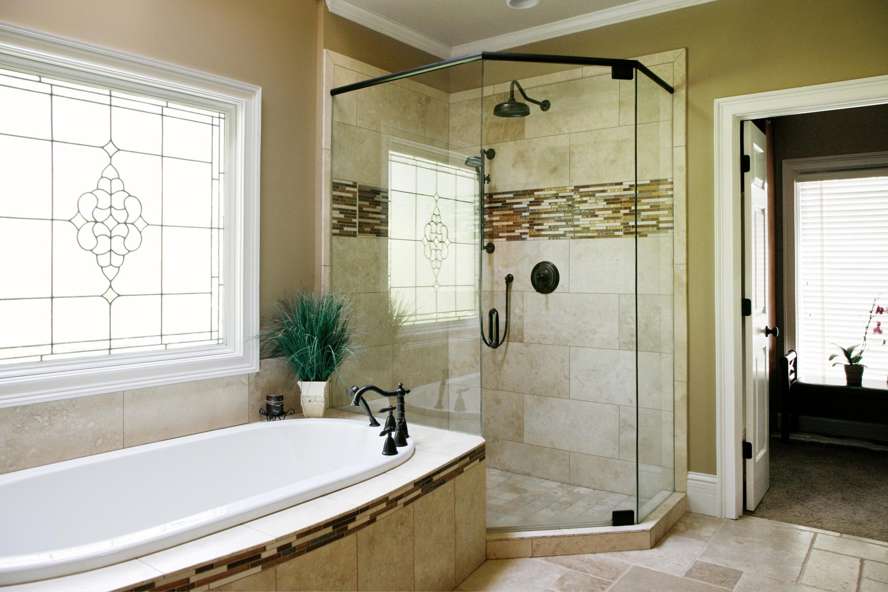 View of garden tub and shower with custom tile work