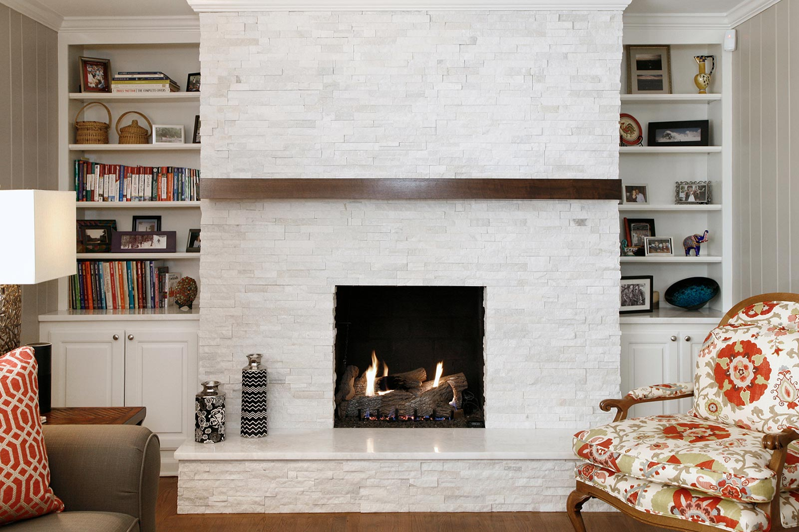 White stone fireplace after remodeling living room