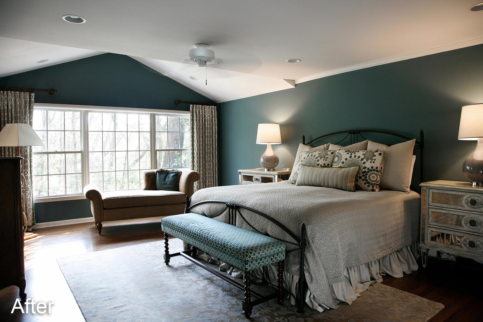 Large bedroom with expansive windows after remodeling