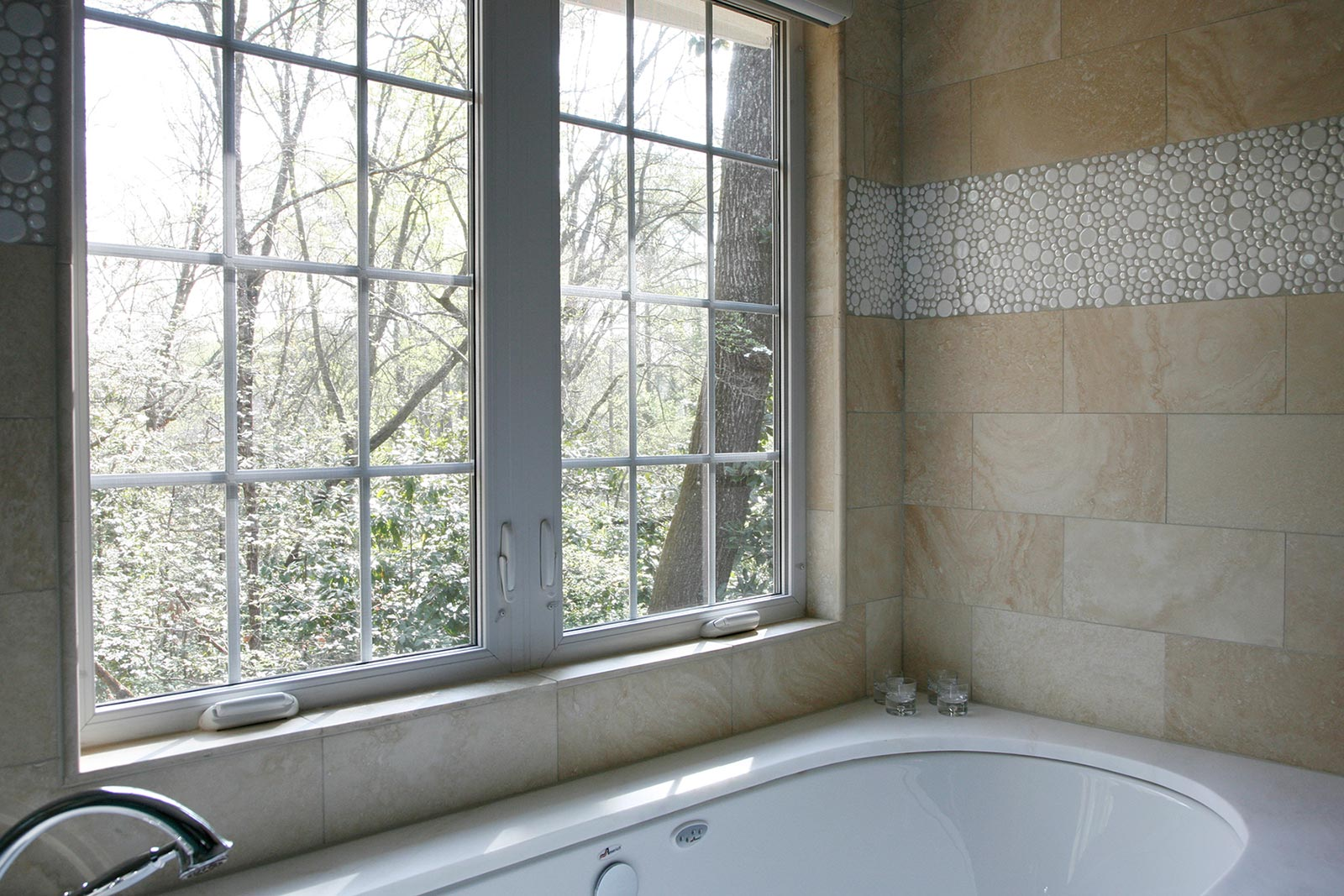 Large windows over garden-style tub