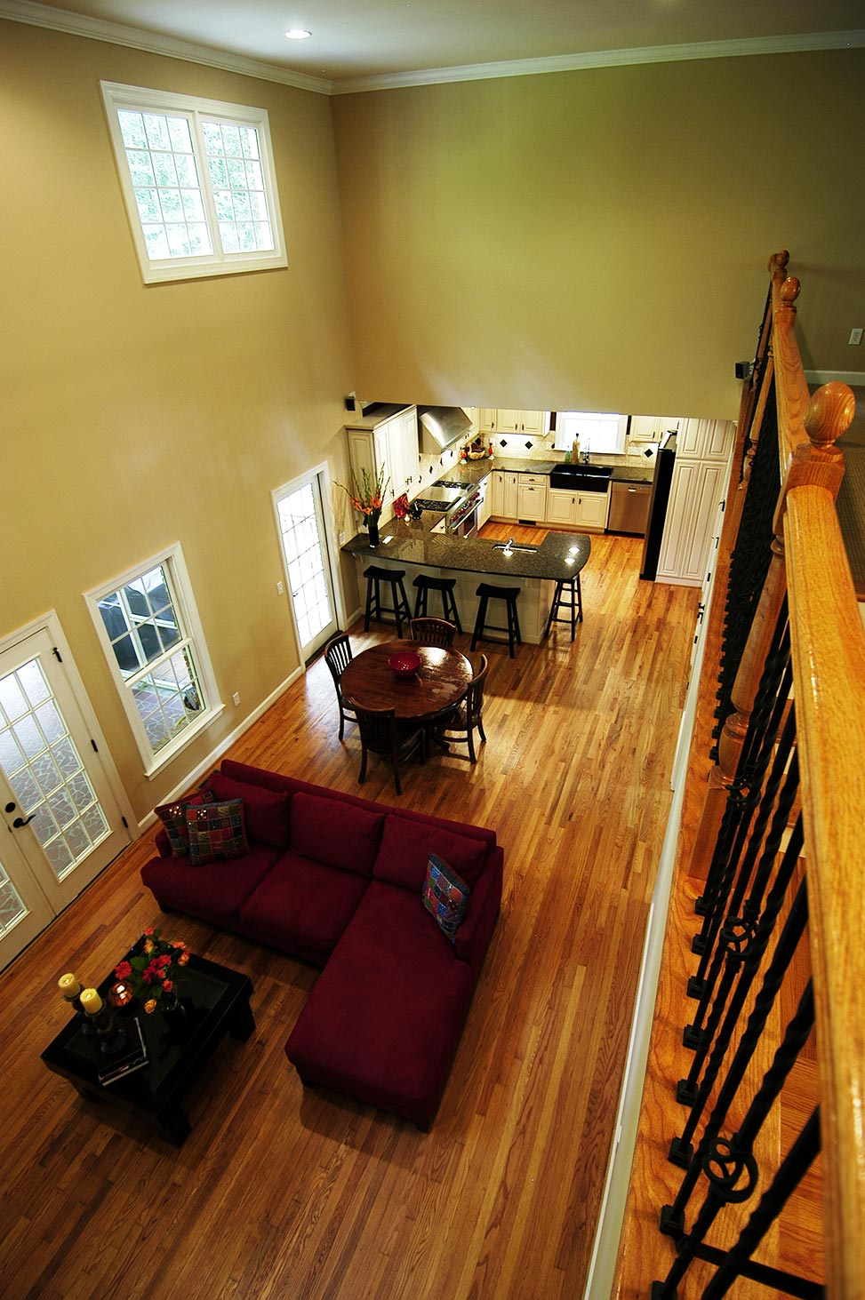 View of living room and kitchen from second floor balcony