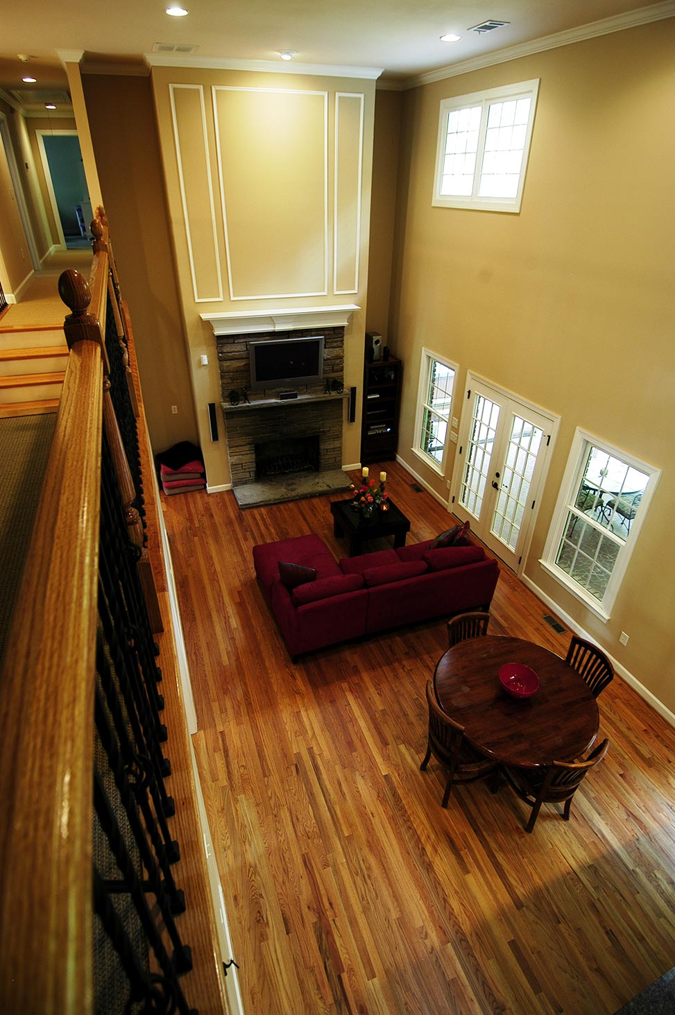 View of living room and fireplace from second floor balcony