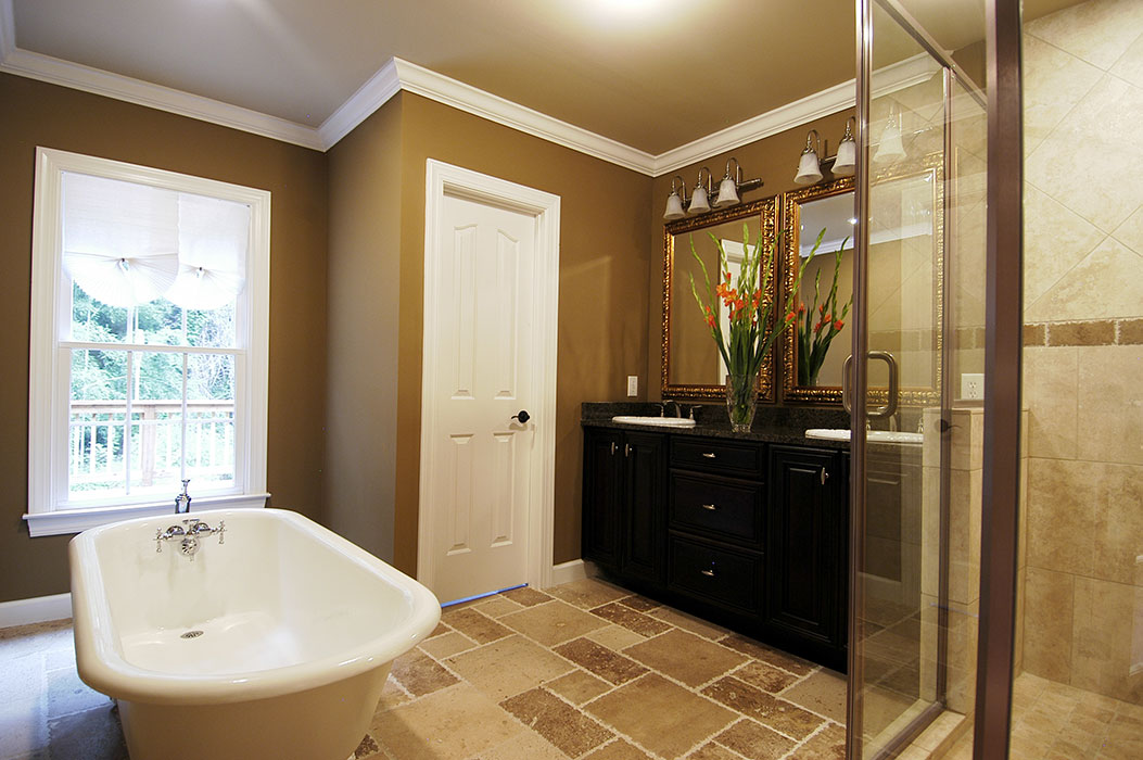 Master bath interior with freestanding tub